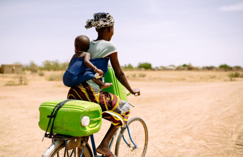 Woman cycling with child