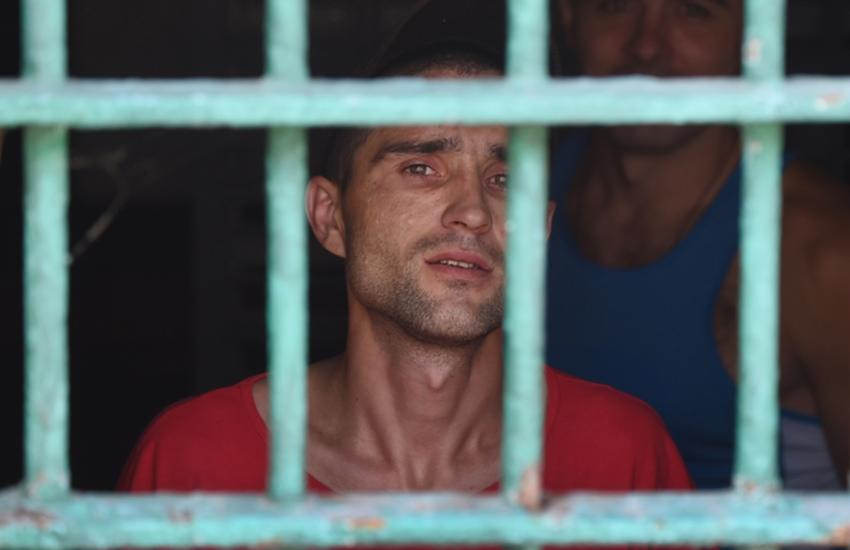 A prisoner looks out from prison cell of Lukyanivska prison in Kiev on July 6, 2018
