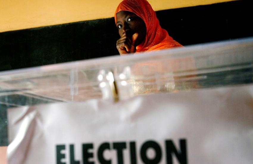 A Senegalese woman waits to cast her ballot at a voting station during presidential elections in the capital Dakar, February 25 2007