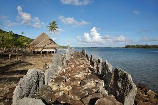 Marae Rauhuru, a stone courtyard with platform and standing stones, built by a Polynesian civilisation