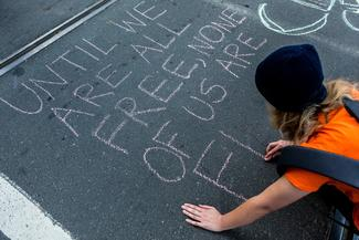 Person writing on the road: human rights day in Australia