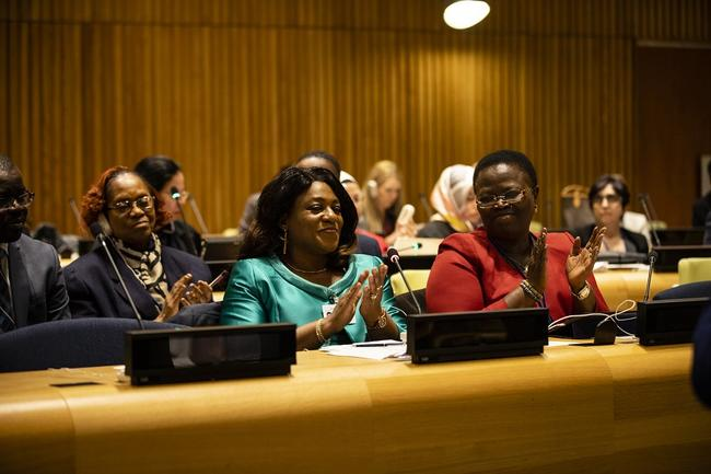 Ladies clapping at IPU event