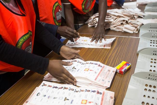 Election officials count ballot papers at a voting station in Lusaka, January 20, 2015